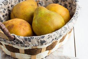 green pears in a basket