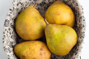 yellow pears on a white top view