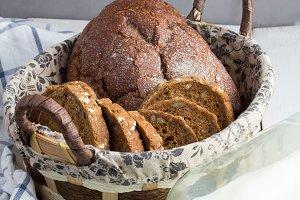 wicker basket with bread,milk,towel