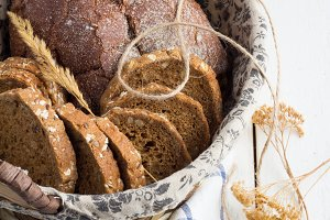 basket with bread and dried flowers