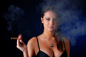 brunet woman with cigar
