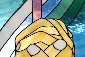Praying hands stained glass