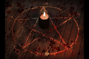 Candle in pentagram circle