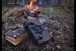Black magic books in fire