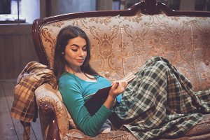 Woman with plaid  is reading