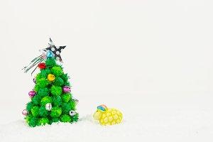sheep looking Christmas tree