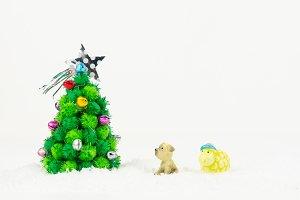 Dog and sheep looking Christmas tree