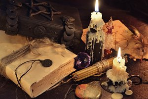 Magic book and candles