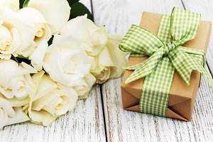 White roses and gift box