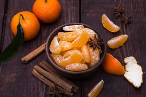 Tangerines with cinnamon stick