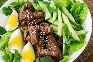 Salad with spicy beef, cucumber
