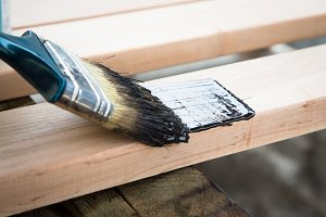 natural wood with paint brush