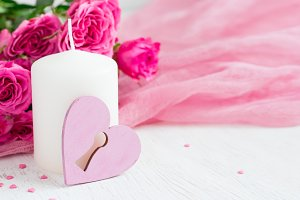 Valentine day background with roses and candle