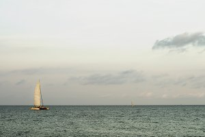 Lonely Sailboat on Horizon