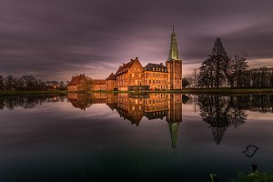 Chateau in landscape with reflection