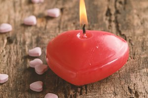 Red heart shaped candle
