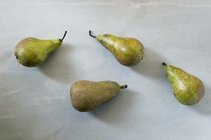 pears on the table's background white
