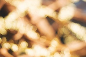 Golden bokeh faded holiday card background
