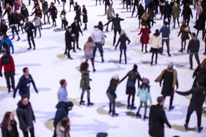 Blurred people ice skate