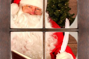 Santa in Window Checking His List
