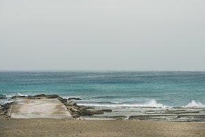Coast and pier at Mediterranean sea