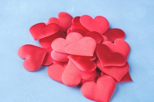 Red hearts on textured blue background