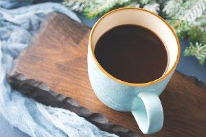 Mug of coffee dark winter background