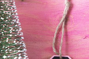 Christmas tree tag on a pink background