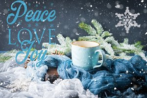Greetings with mug of coffee on winter background