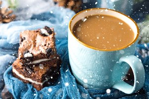 Brownies and coffee with falling snow