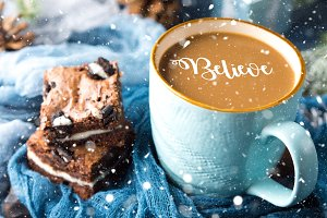 Brownies and coffee with falling dreamy snow