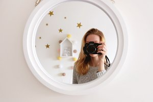 Girl, mirror, stars, cotton balls.