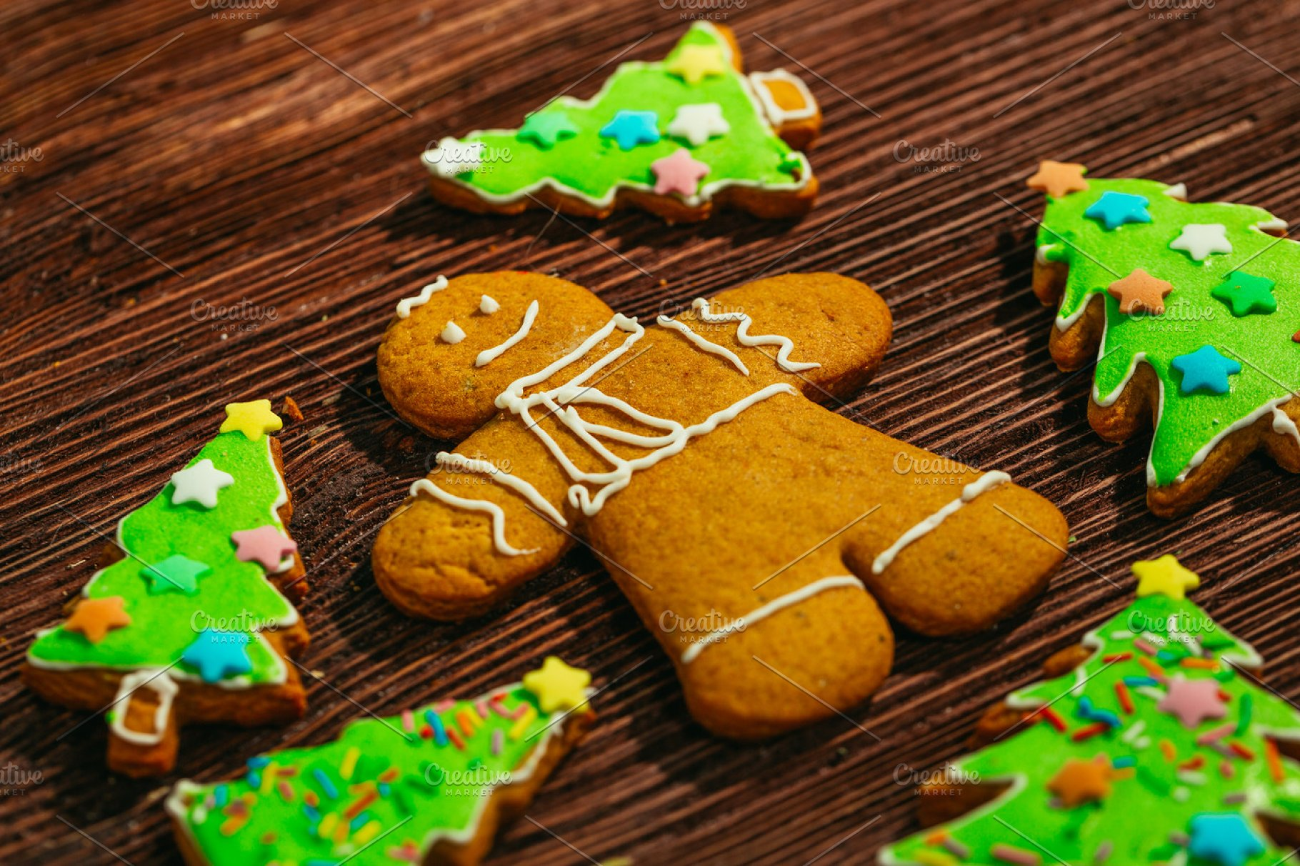 Painted Gingerbread Christmas Tree And The Man On A Wooden Background
