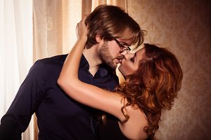 Elegant couple are kissing