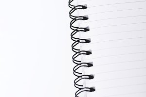 Notepad with rings on white background