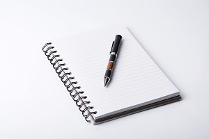 Clear paper and pen on white background.