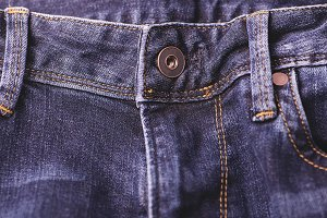 A button in blue jeans