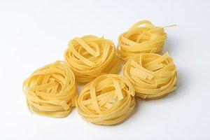 Raw pasta on white table
