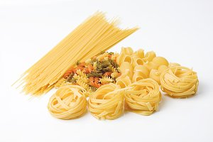 Four kinds of pasta on white table