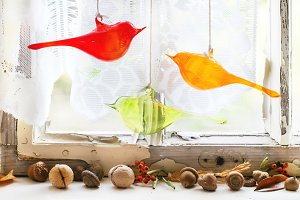 Interior window with glass birds