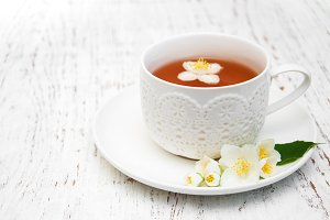 Cup of tea with jasmine flowers
