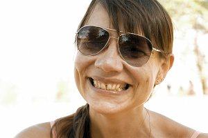 Woman is laughing expressively and emotionally