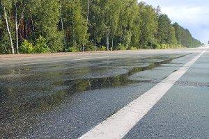 Wet road highway with mist splash