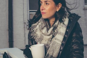 Girl with a cup of coffee