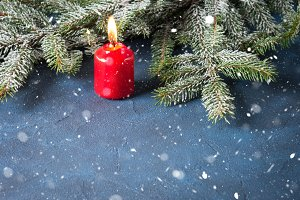 Dark christmas background with red candle