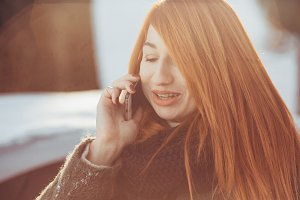 red-haired girl talking on the phone