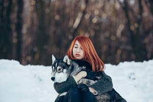 red-haired girl with a dog