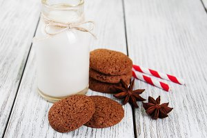 Oatmeal cookies and bottle of milk