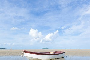 small boat on the beach