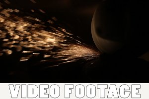 Sparks fly from grinding machine